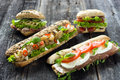 Mixed sandwiches on a wooden background Stock Photos