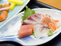 Mixed sashimi raw fish on traditional japanese plate Royalty Free Stock Photos