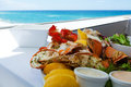 Mixed seafood plate by a tropical beach Stock Image