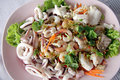 Mixed seafood salad in dish the thai food made form shrimp fish shellfish squid and assorted vegetables Stock Images