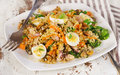 Mixed seafood salad with quinoa and quail eggs. Royalty Free Stock Photo