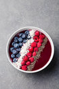 Mixed smoothie bowl raspberry blueberry chia seeds Royalty Free Stock Photo