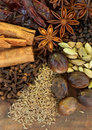 Mixed Spices on a Wood Background Royalty Free Stock Images