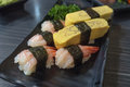 Mixed sushi set with fresh shrimp and egg served in japanese restaurant Royalty Free Stock Image