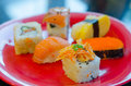 Mixed sushi set on a red plate favorite japanese food Stock Photo