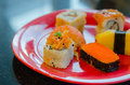 Mixed sushi set on a red plate favorite japanese food Royalty Free Stock Photos