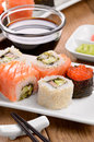 Mixed sushi on a white plate with soy sauce wasabi and  ginger Royalty Free Stock Image