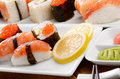Mixed sushi on a white plate with soy sauce wasabi and  ginger Stock Image