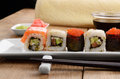 Mixed sushi on a white plate with soy sauce wasabi and ginger Royalty Free Stock Images