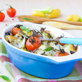 Mixed vegetable in blue bowl baked in the oven with cheese and b vegetables potato zucchini eggplant tomato mozzarella delicious Stock Photography