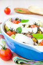Mixed vegetable in blue bowl baked in the oven with cheese and b vegetables potato zucchini eggplant tomato mozzarella tasty Royalty Free Stock Images