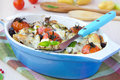Mixed vegetable in blue bowl baked in the oven with cheese and b vegetables potato zucchini eggplant tomato mozzarella tasty Royalty Free Stock Photography