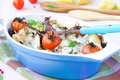 Mixed vegetable in blue bowl baked in the oven with cheese vegetables potato zucchini eggplant tomato mozzarella delicious Royalty Free Stock Photography