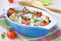 Mixed vegetable in blue bowl baked in the oven with cheese vegetables potato zucchini eggplant tomato mozzarella delicious Royalty Free Stock Photos