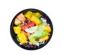 Mixed vegetable and fruit salad in black bowl Royalty Free Stock Photo
