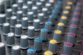Mixing console audio closeup with small depth of field Royalty Free Stock Photo