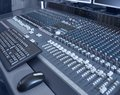Mixing console blue toned picture of a sound board detail Stock Photo