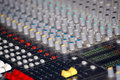 Mixing console in professional audio a or audio mixer also called a sound board desk audio production or mixer is Royalty Free Stock Photography