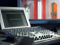Mixing deck and monitor in recording studio closeup of Royalty Free Stock Photo