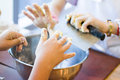 Mixing dough for cookies in a large metal bowl Royalty Free Stock Image