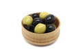 A mixture of black and green olives wooden bowl Royalty Free Stock Photo