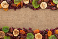 Mixture of dried fruits lying on sackcloth space for text Royalty Free Stock Photos