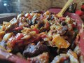 Mixture of fried vegetables and meat ready to go into the oven