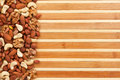 Mixture of nuts lying on a bamboo mat Royalty Free Stock Image