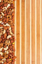 Mixture of nuts lying on a bamboo mat Royalty Free Stock Photos