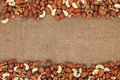 Mixture of nuts lying on sackcloth with space for text Royalty Free Stock Photography