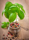 Mixture of pepper peas in an old bowl and basil leaves Royalty Free Stock Photos