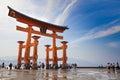 MIYAJIMA, JAPAN - MAY 27: Tourists walk around the famous floating torii gate of the Itsukushima Shrine on Miyajima at low tide sh Royalty Free Stock Photo
