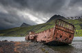Mjoifjordur, Iceland - Abandoned fishing boat rusts in fjord Royalty Free Stock Photo