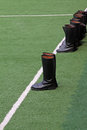 Mlitary boots and White line on green lawn Royalty Free Stock Image