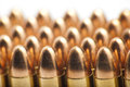 Mm bullets in a row on white background Stock Photography