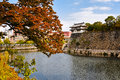Moat and red leaves surrounding protecting osaka castle osaka castle is a japanese castle in osaka japan Royalty Free Stock Photos