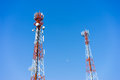 Mobile cellular tower antennas with blue sky background Stock Photos