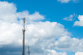 Mobile communications tower on the sky background. Large clouds. Aerials of cellular communication. GSM Tower. Covering mobile. Royalty Free Stock Photo