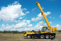 Mobile crane with risen boom Royalty Free Stock Photo