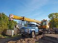 Mobile crane vintage russian in country farm yard Royalty Free Stock Photos
