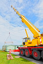 Mobile home caravan crane a is moving a through the air to place in its new spot Royalty Free Stock Photography