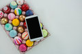 Mobile kept on painted Easter eggs in egg carton Royalty Free Stock Photo