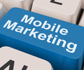 Mobile marketing key shows online sales and promotion showing Royalty Free Stock Photos