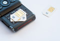 Mobile memory Sim cards on a mobile phone Royalty Free Stock Photo
