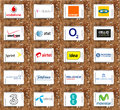Mobile operator logos of famous operators in the world on white tablet on rusted wooden background brands like vodafone t orange Royalty Free Stock Photography