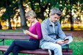 Mobile phone addiction concept - couple looking at their mobile Royalty Free Stock Photo
