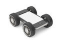 Mobile phone with blank screen on wheels a white background Stock Photos