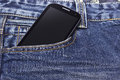 Mobile phone in blue jeans the pocket of Stock Image