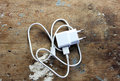 Mobile phone charger white on rustic wooden backround Royalty Free Stock Photography