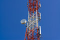 Mobile phone communication antenna tower with satellite dish on Royalty Free Stock Photo